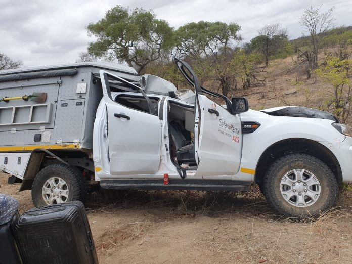 safari vehicle kruger park south africa giraffe accident
