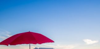 bloubergstrand red umbrella beach cape town table mountain